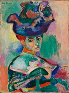 "Henri Matisse- Woman with a Hat (1905) Fauvism is the style of les Fauves (French for ""the wild beasts""), a loose group of early twentieth-century Modern artists whose works emphasized painterly qualities and strong color over the representational or realistic values retained by Impressionism."