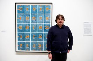 George Widener in front of one of his Magic Square pieces.