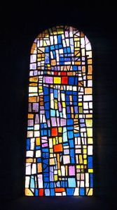 One of Roger Bissiere's stain-glass window designs in Cornol.