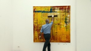 Artist Gerhard Richter at work, as seen in Corinna BelzÕs documentary GERHARD RICHTER PAINTING.  Courtesy of Kino Lorber.