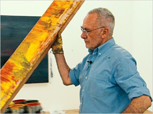 Gerhard Richter with a huge squeegee.