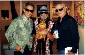 From Santa Monica Mirror- Artist Gary John (center) has gone from living on the streets of Venice to becoming an emerging artist in the past eight months thanks to gallery owners Bruce (left) and Scot Lurie.